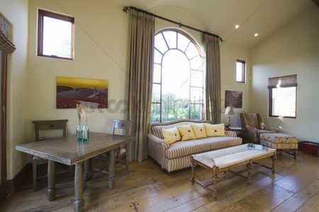 Spacious : Arched window and sofa in living room with high ceiling