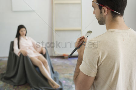 Paint brush : Artist observing artist s model in studio