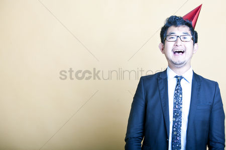 Excited : Asian business man wearing party hat