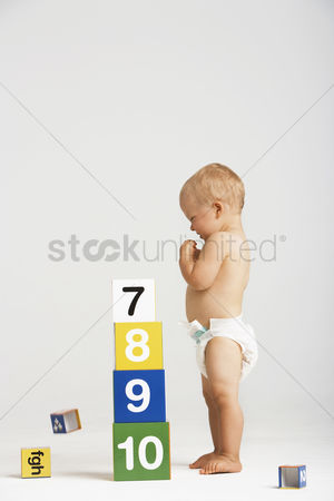 Children : Baby playing with building blocks