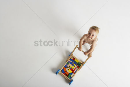 Babies : Baby pushing toy cart