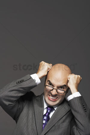 Bald : Bald businessman fists on head pounding head making a face