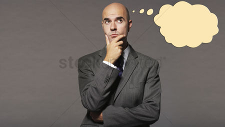 Bald : Bald businessman thinking with speech bubble over gray background