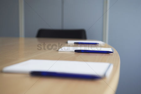 Notepad : Ballpoint pens and notepads on conference table