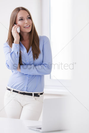Cell phone : Beautiful businesswoman using cell phone