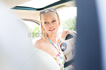 On the road : Beautiful woman looking back while driving car