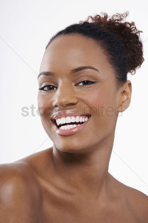 Smiling : Beautiful young black woman hair back