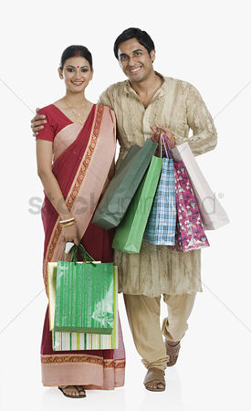 Shopping background : Bengali couple carrying shopping bags
