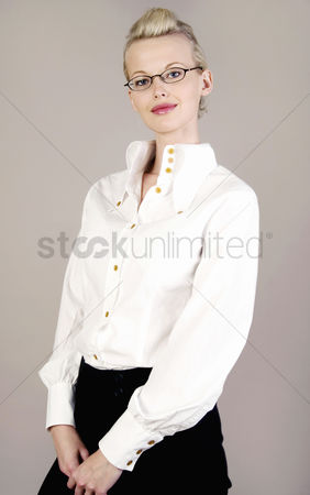 Supervisor : Bespectacled woman flashing a smile at the camera