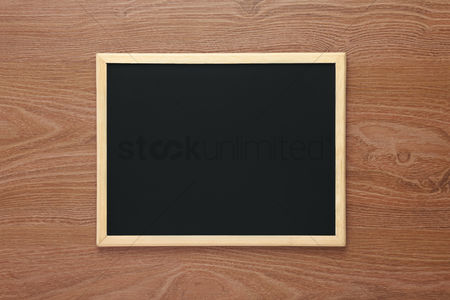 Flat : Blackboard on desk background with copy space