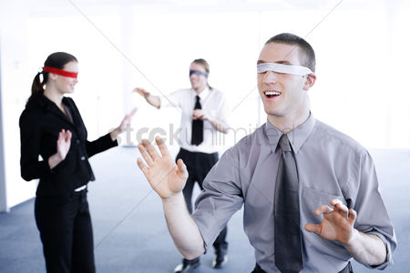 Conceptual : Blindfolded business people finding their ways