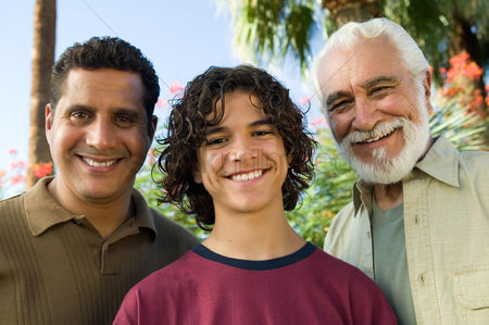 Offspring : Boy  13-15  with father and grandfather outdoors front view portrait