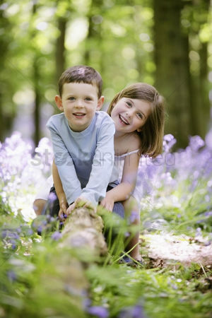Spring : Boy and girl sitting on tree root
