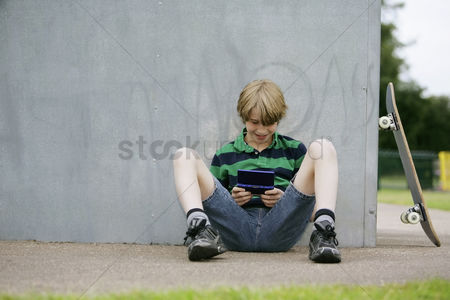 Portability : Boy playing handheld video game