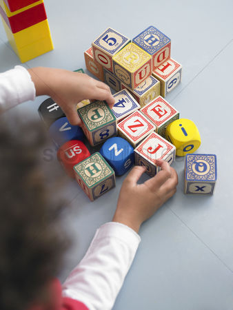 Pile : Boy playing with building blocks in classroom view from above