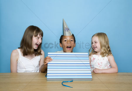 Birthday present : Boy showing happiness after unwrapping his present