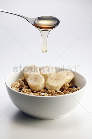 Ready to eat : Breakfast of muesli with banana  milk and honey