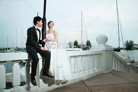 Elegance : Bride and groom smiling and holding hands