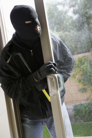 Thief : Burglar breaking into house