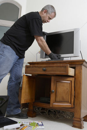Thief : Burglar stealing television in house