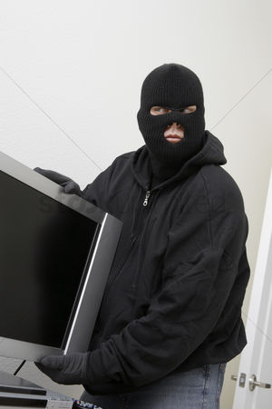 Thief : Burglar stealing television set