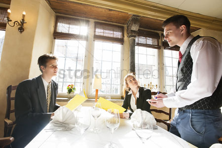 Notepad : Business couple ordering food at restaurant table