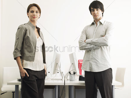 Interior background : Business man and woman standing in office