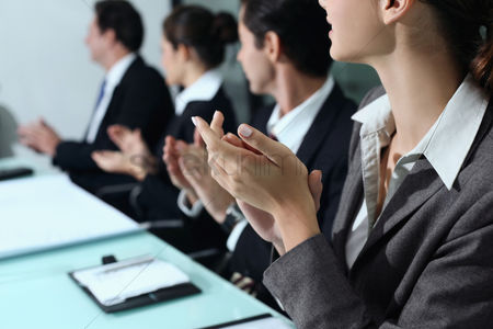 Satisfaction : Business people clapping hands at meeting