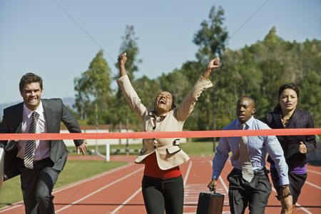 Business suit : Business people crossing the winning line