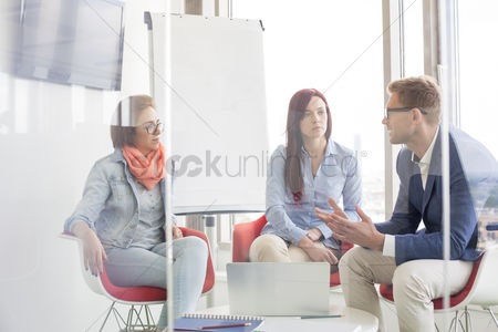 Ideas : Business people discussing in meeting room