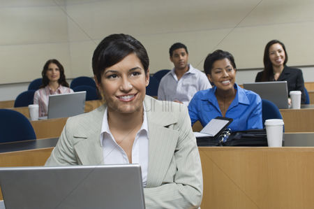 Mid adult man : Business people sitting in classroom