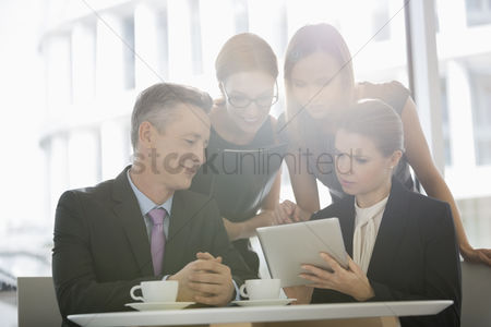 Office worker : Business people using digital tablet together in office cafeteria