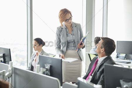 Businesswomen : Business people working in an open plan office