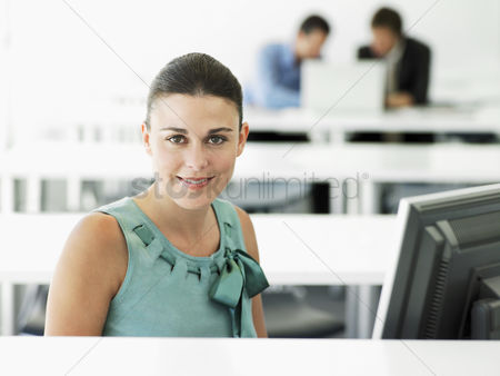 Interior background : Business woman at computer portrait