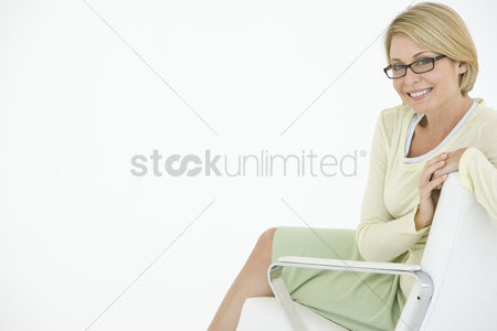 Background : Business woman sitting in chair portrait
