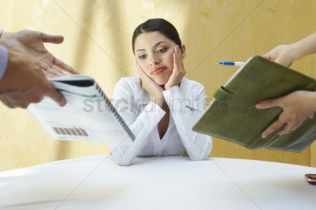 Contemplation : Business woman working with colleagues in office