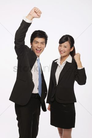Celebrating : Businessman and businesswoman celebrating their success