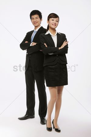 Attitude : Businessman and businesswoman with their arms crossed