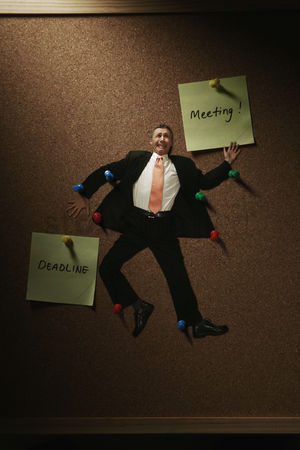 Notepad : Businessman being pinned up on the notice board