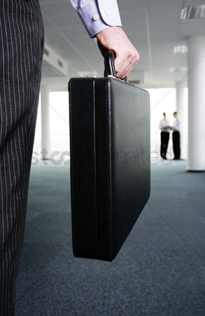 Determined : Businessman carrying a briefcase