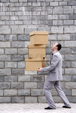 Careful : Businessman carrying a stack of boxes