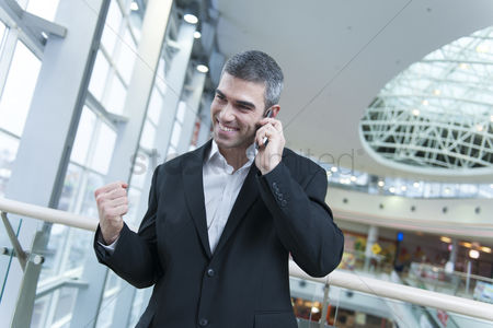 Czech republic : Businessman celebrates talking on mobile phone