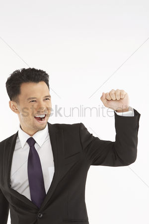 Excited : Businessman cheering with fist in the air