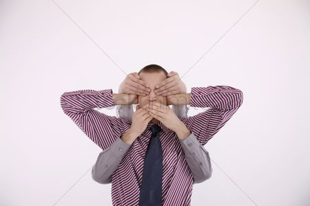 Ignorance : Businessman covering ears  another two pairs of hands covering his eyes and mouth