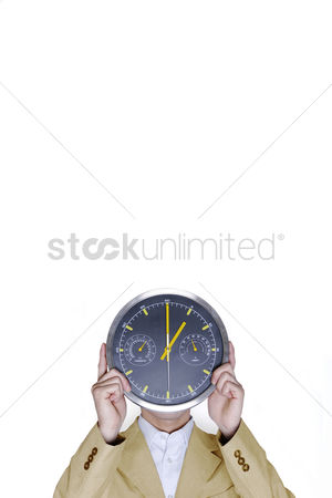 Vision : Businessman covering his face with a clock