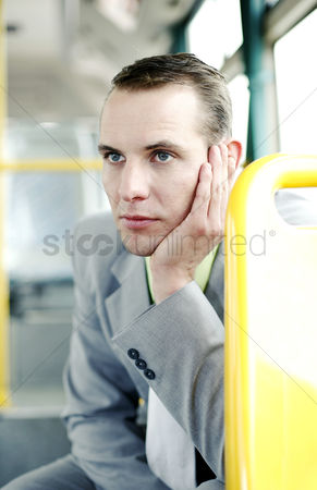 Wondering : Businessman daydreaming in the train