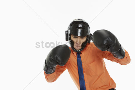 Fight : Businessman dressed with boxing gear