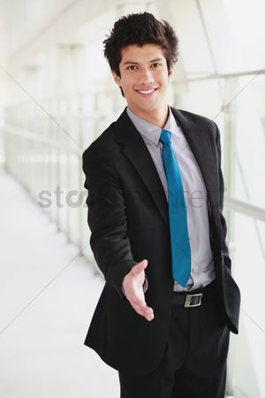 Pocket : Businessman extending hand to shake