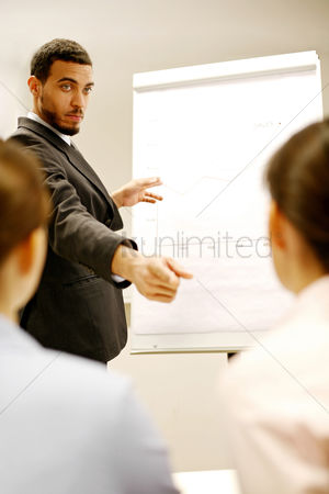 Determined : Businessman giving presentation in the conference room
