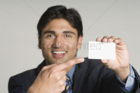 Corporation : Businessman holding a blank placard